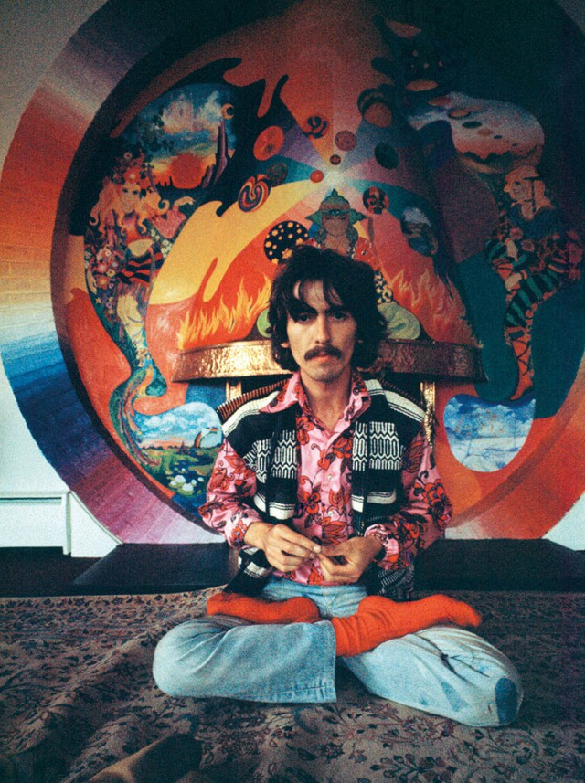 George in front of a fireplace painted by The Fool at his home (© Harrison Family)