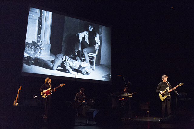 Dean Wareham performing to . Kiss the Boot (excerpt) (1966)     16mm film, black and white, silent, 4.5 minutes at 16fps; with Gerard Malanga, Mary Woronov (Photo by Rebecca Greenfield)
